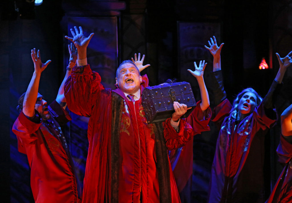 Ron Wisniski as Father McDuffy and the cast of CHRISTMAS IN HELL